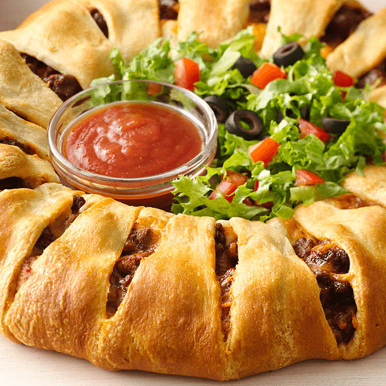 Taco Crescent ring served with red sauce and salad